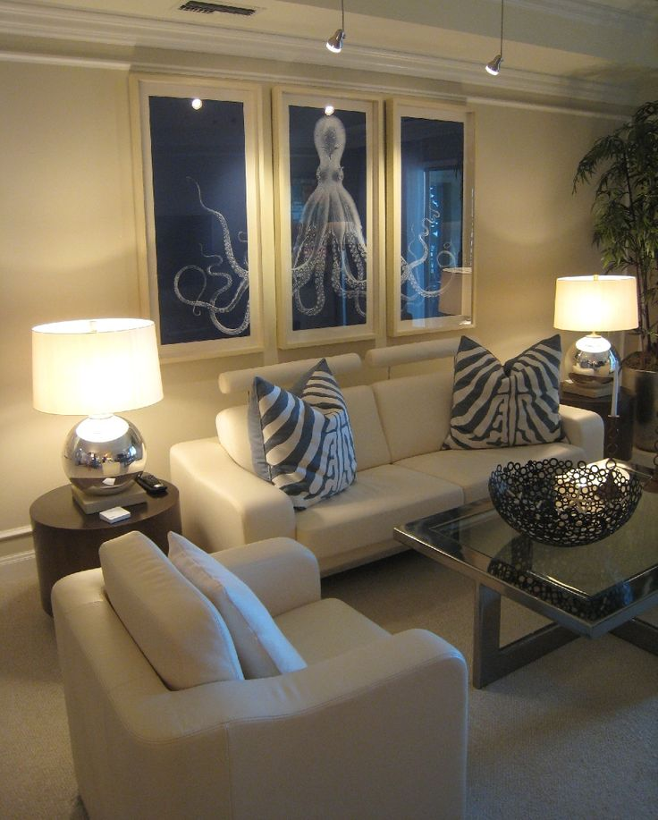 Love the furniture(ahp)Lord Bodner Blue Octopus Triptych. I love this white  octopus on the deep blue background. And I love triptychs.