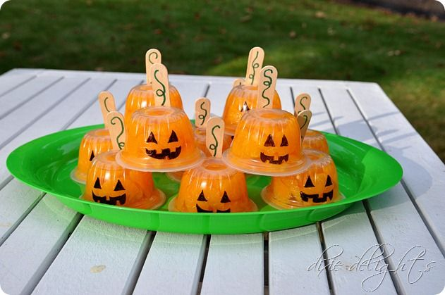 ~ Healthy Halloween: Invert Dole mandarin cups, Sharpie a black face on, & tape a wooden spoon to side. They'll be the hit of the party.