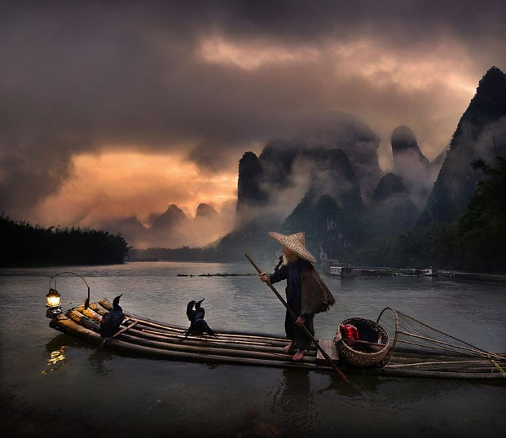 Cormorant fisherman by  Weerapong Chaipuck