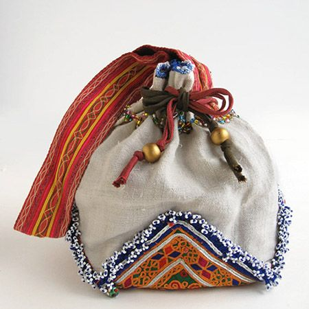 Another Bixby hamper? cloth bag with embroidered textile.