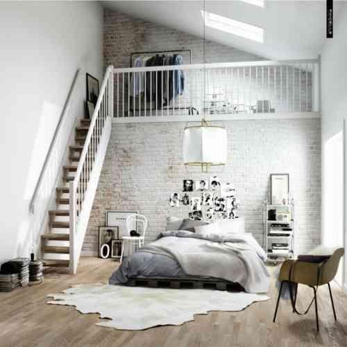 papiers peints imitation brique blanche dans la chambre à coucher de style industriel