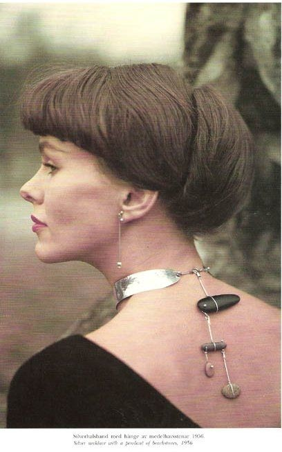 Jeweler Vivianna Torun Bulow-Hube, wearing one of her own necklace creations .. sterling silver with beach stones, ca. 1950s
