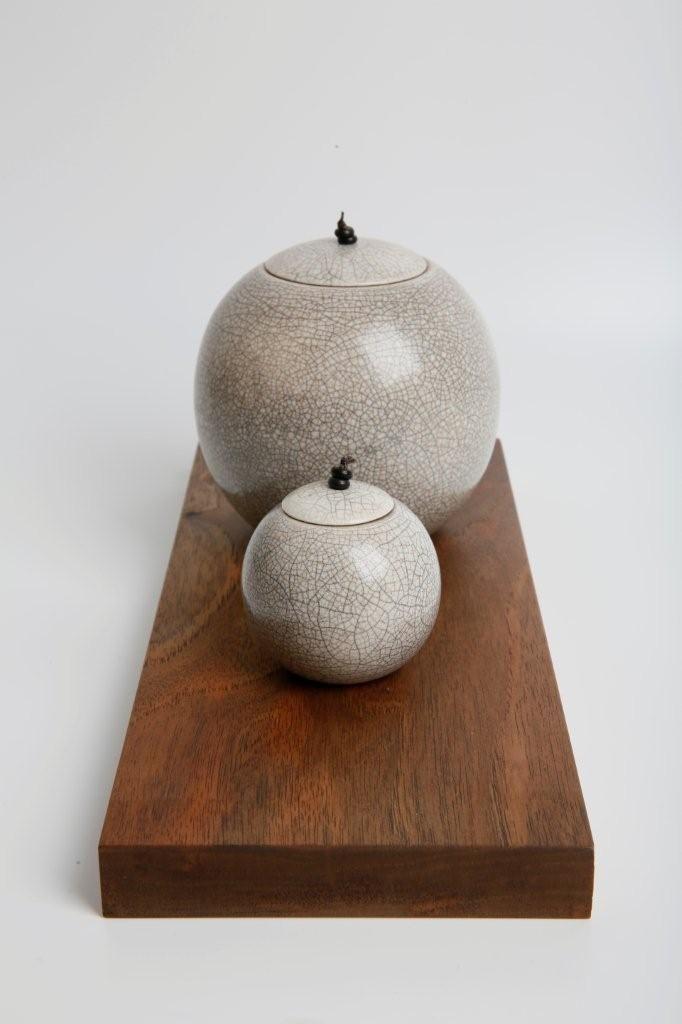 Raku Spheres on walnut - installation by Kate Schuricht