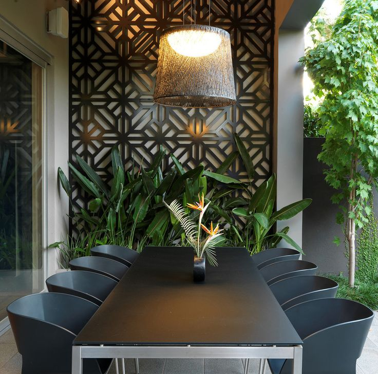 Contemporary Patio by MR.MITCHELL - lasercut running from the roof down the wall seamlessly is beautiful