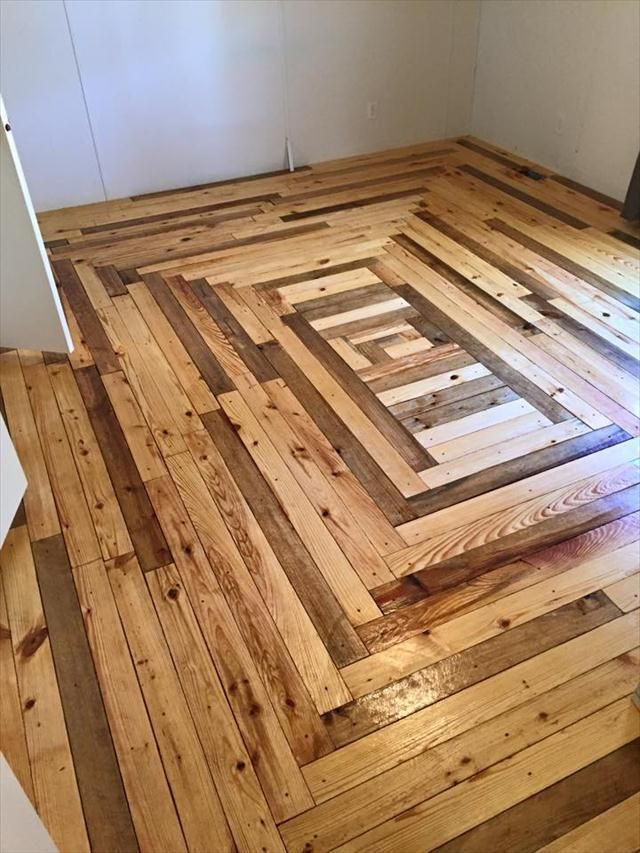 Wide pallet boards in a great pattern for a wood floor. Use the largest pieces first to work you way to the center, then you can change direction to fill the center! Nice.