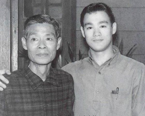 Bruce Lee with his father. Bruce was the son of Cantonese opera star Lee Hoi-Chuen.