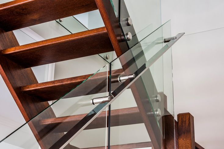 Glass balustrade on timber staircase.  Finished with custom made stainless steel handrails.