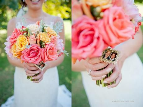 Navy, coral and pink wedding bouquet with sentimental brooch. Flowers by www.botanica-flowers.co.za. Photography by www.cherylmcewan.co.za