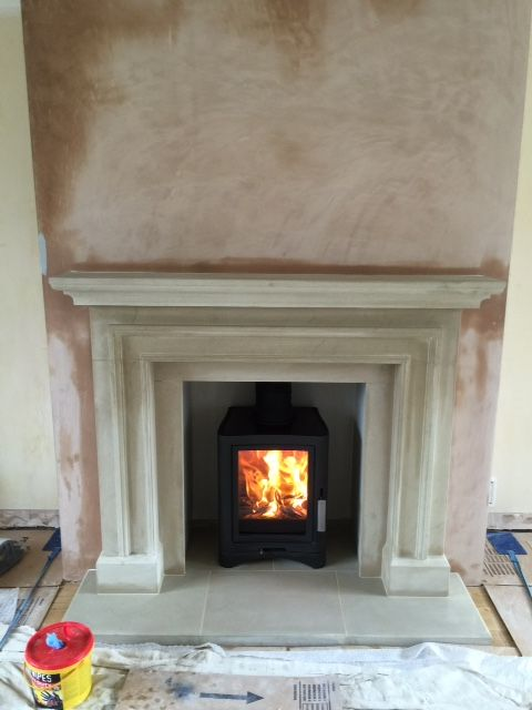 Another recent installation... The impressive hand carved bespoke sandstone fireplace complimented with the Evo wood burner stove.