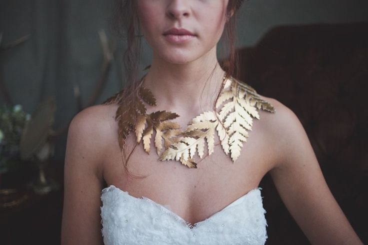 Fabulous shimmering statement collar with six fern leaf silhouettes. The leaves are hand cut from Italian leather in colours Rich Gold and Antique Gold, creating a beautiful brassy tone. The Eugenie collar is ribbon tied and looks amazing worn with a strapless gown or as a collar to higher necked dresses. Also a great everyday accessory! Go all out and team with the Eugenie headpiece or Eugenie Clip. This piece is handmade to order and will ship within 3-4 weeks after payment has been ...
