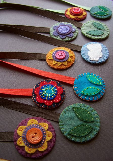 Ribbon bookmarks tipped with applique felt medallions.  By Amy, soleilgirl (via Flickr)