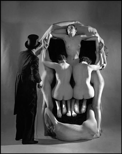 """In Voluptas Mors, portrait of Salvador Dalí posing beside a giant """"skull"""", a tableau vivant comprising of seven nude female models. It was made in collaboration with Phillipe Halsman, 1…"""