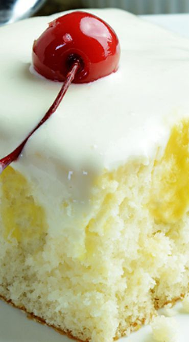 """Dole Whip Poke Cake-inspired by Disneyland Tiki Tiki. As a foodie purist I would make my own white cake, pineapple custard and soft whip real cream from scratch, but this recipe just looked absolutely delicious! Pineapple enzymes presents all kinds of curdling problems with dairy anyway so it would be a challenge to """"purist perfect it."""""""