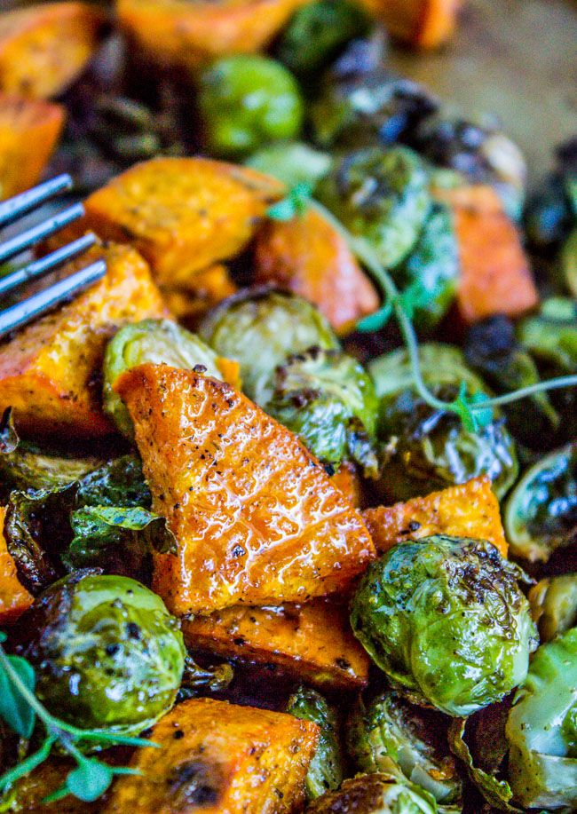 Roasted vegetables (like these Brussels sprouts and sweet potatoes) are amazing. Make them ahead and reheat! Perfect healthy side dish for Thanksgiving and Christmas!