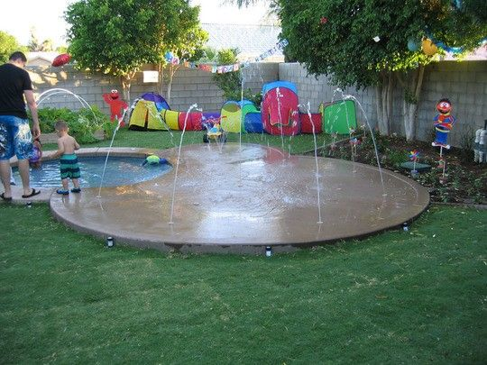 This is awesome! Hot tub for adults and a little kiddie pool with splash pad! Splash pad could double as lounge seating with fire pit for nighttime entertaining. This would be an awesome feature in a small yard.