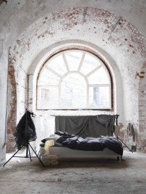 Vaulted ceiling Bedroom with beautiful Arched White Window.