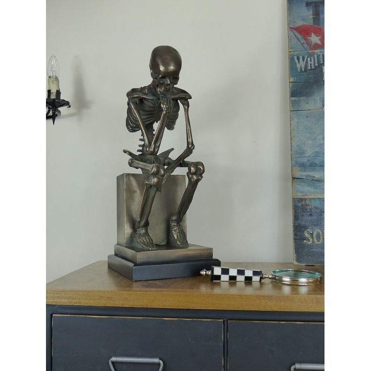Deep in thought, our seated skeleton has an authentic antique feel. Finished in bronze with subtle green weathered enamel and aged to perfection for maximum impact. Our Bronze skull ornament is highly sought after and adds drama to any room. He's tall, super heavy, and extremely robust. Handmade from high quality resin and power coated in a bronze effect enamel paint.
