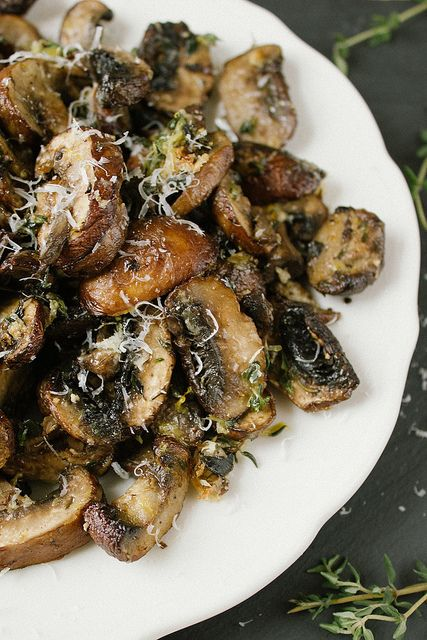 Baked Lemon and Thyme Mushrooms. This is comfort food made for dark, chilly days when you want the oven on and warming your kitchen. The earthiness of the mushrooms and thyme is balanced by the brightness of the lemon and the sharpness of the parmesan. This mixture goes beautifully on toast, a bed of polenta or even mixed into some fresh pasta. #mushrooms
