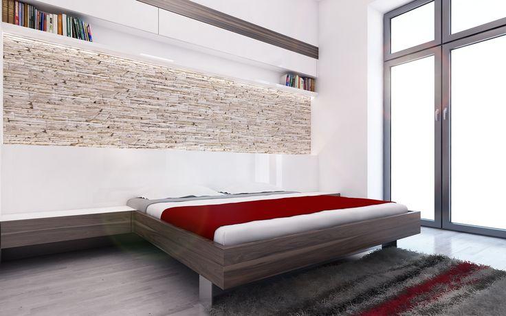 Ložnice je pojata minimalisticky. Čelo postele probíhá přes celou zadní stěnu místnosti, která je obložena kamenným obkladem z přírodního kamene. Nad kamenným obkladem jsou umístěny další otevřené i uzavřené úložné prostory.
