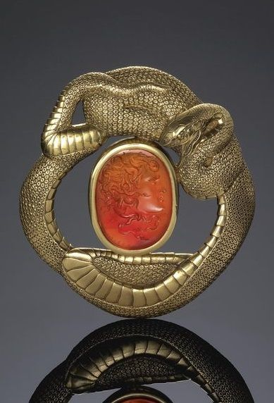 Gold and Carnelian Intaglio Brooch by Bernini   circa 1860. Designed as a serpent encircling the carnelian intaglio depicting Medusa, carved by Bernini.