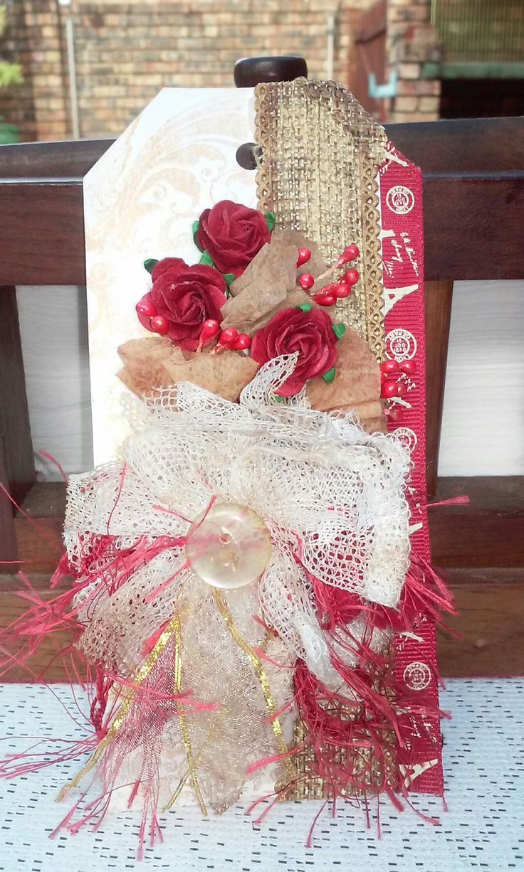 Tag idea. Shabby chic style. Layers ribbon, burlap with flowers in red and white.