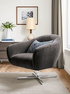 Our Carlo accent chair gives a nod to the past, but includes details you'll appreciate now. The low swivel seat is perfect for lounging, but supportive enough for long conversations. The chrome base offers stability and the precise tailoring keeps the curvy frame looking neat and polished.