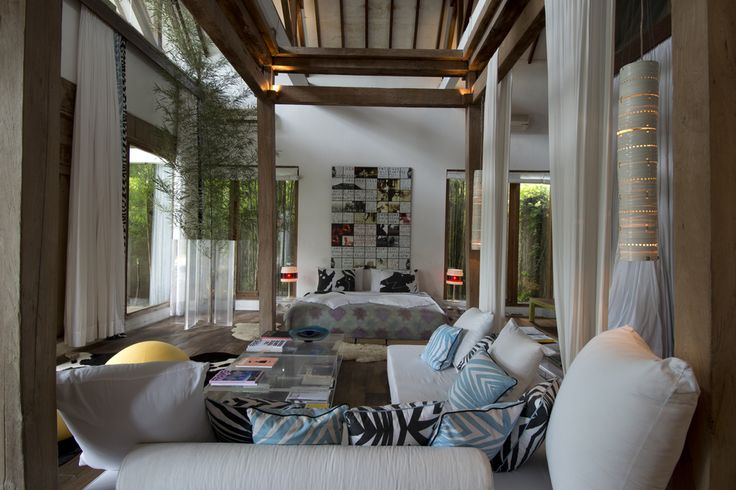 Master bedroom of Valentina Audrito's Home Bali.A Tropical Rustic Modern dream house is a traditional joglo updated.