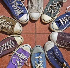 "The circle formed by the tips of these sneakers represent the gestalt law of continuity: ""the brain does not prefer sudden or unusual changes in the movement of a line"" (47). Read more about gestalt theories: http://alisonjungj7510.wordpress.com/2012/02/01/pinning-down-gestalt-laws/"