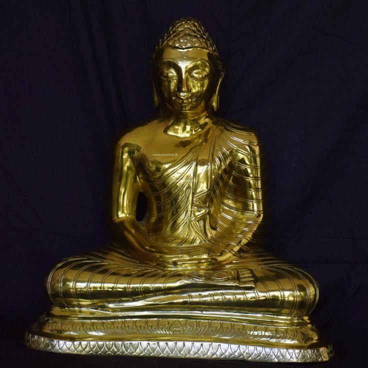 Small brass statue of meditating Buddha