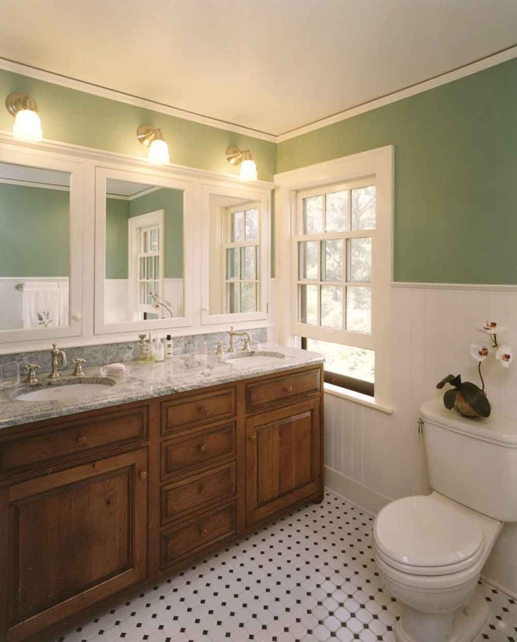 Traditional bathroom with white beadboard, marble counters, hex floor tile.