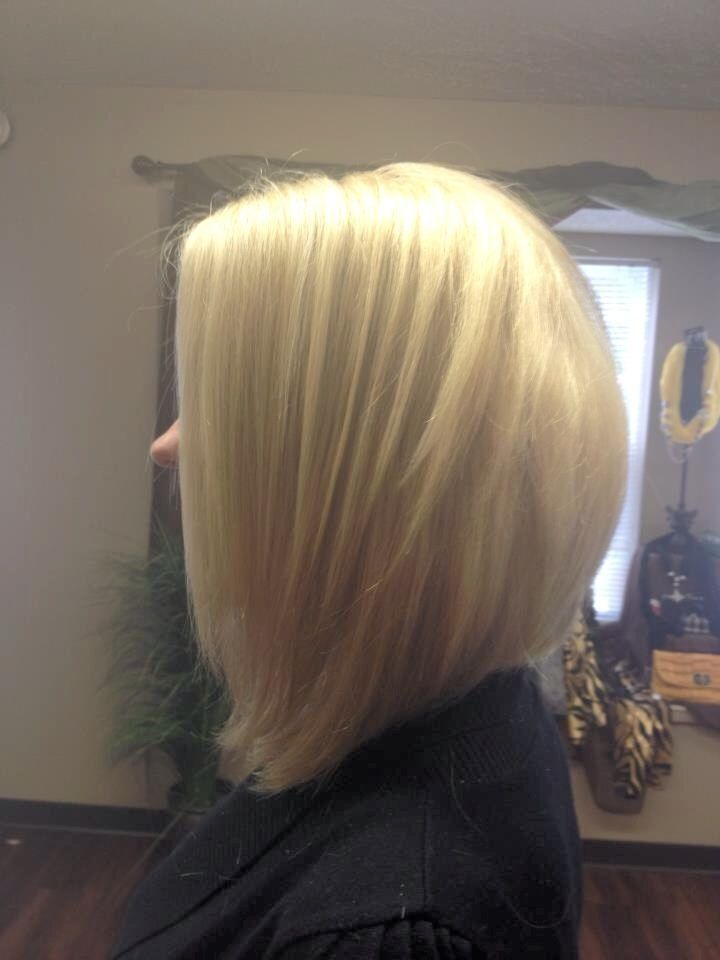Elements Hair & Nail Studio Stylist: April Sommers Color: buttery Blonde / Cut: Long Angled Bob from long hair
