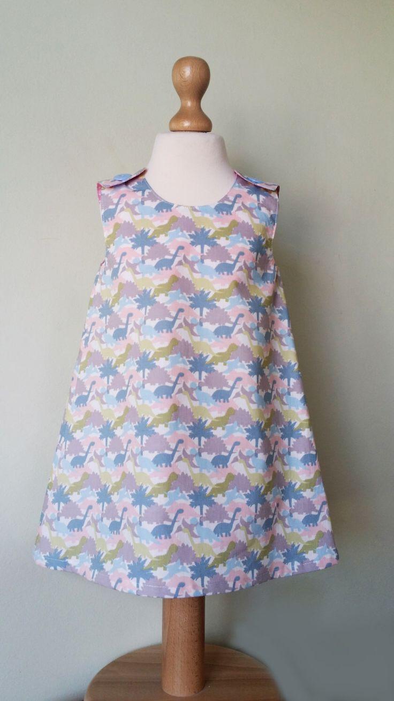 Dinosaur dress, girls pinafore, spring dress, dino clothes, kids clothing, uk by JackandRoseCrafts on Etsy https://www.etsy.com/listing/271319016/dinosaur-dress-girls-pinafore-spring