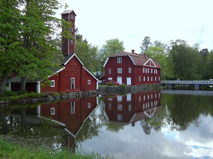 """A hose tower and """"Gracehouse"""" of Strömfors Bruk at Strömfors bruk in Ruotsinpyhtää, Finland. The Armonlinna was built in 1824 to home the house manager and office personnel. - Armonlinna ja paloasema, Störmforsin ruukki, Ruotsinpyhtää - Photo: Pöllö/Wikimedia"""