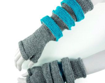 """Orbit is a soft 3-D jewellery cuff or pair of armbands / arm warmers. The cuff extends and shrinks with a paper-fold precision.  Orbit is a design from the MFTI Outpost collection. MFTI OUTPOST is an astro knitwear pattern collection for the atomic DIYer. """"Knitted retro-futurism from the last outpost in the galaxy.""""  This purchase is for 1 PDF knitting pattern not the finished item. This PDF pattern is available for instant download.  - Written in english with metric measurements. - Full…"""