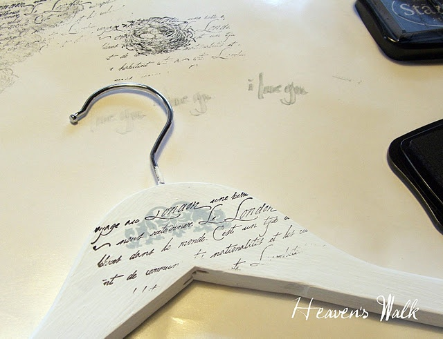 totally doing this...painted hangers with script stamp. yes!