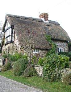 Wepham Cottage in the village of Burpham, England.  English storybook cottage. Burpham is in the Arun District of West Sussex, England. The village is on an arm of the River Arun slightly less than 2 miles northeast of Arundel. (V)