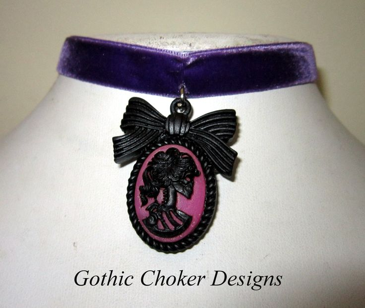 Purple velvet choker with pink skeleton cameo. R120 approx $12. Purchase here: https://hellopretty.co.za/gothic-choker-designs/purple-choker-with-pink-skeleton-cameo