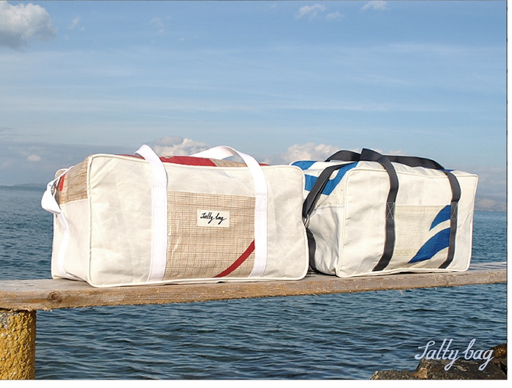 Luggage and messenger bags made from recycled sails in Greece. I want a Salty Bag!