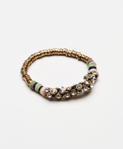 This fun bracelet is all you need to finish off that perfect party look. Glass beads and shell make this piece a true stunner.
