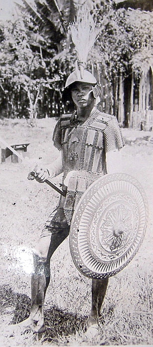 Moro warrior, from the Philippines, early 1900, shown wearing locally made mail and plate armor and European influenced brass helmet.