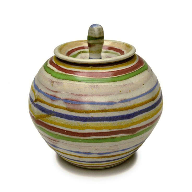 Jar with spinning top lid