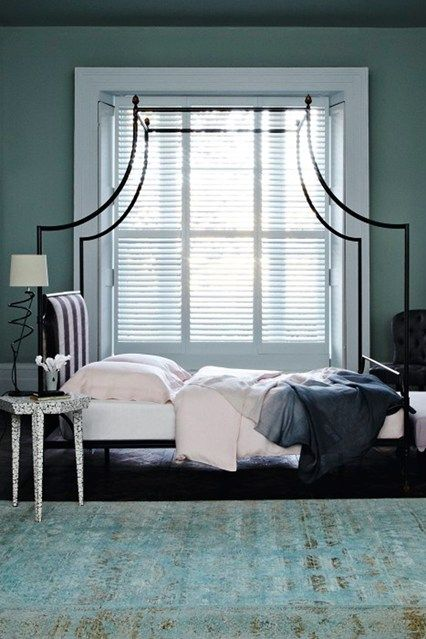 Against the backdrop of dip-dye fabrics and tactile textures, create a restful blue bedroom scheme with pretty pastels - and a statement bed. Iron bed, 'Loire' (Parisian steel), by Niermann Weeks, 234 x 208 x 157.5cm, £11,364 at Tatiana Tafur, with headboard in 'Soho Brush' (cachou), linen, £130 a metre, from Dedar.