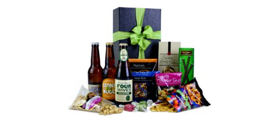 With boutique beers, nuts, snacks, chocolates, truffles, peanuts, pretzels and plenty more, he'll be thrilled with this gift basket.  #giftsforhim #giftbaskets