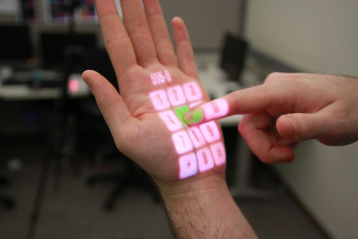 Omni Touch by Microsoft Research and CMU is a wearable projection system which can superimpose keyboards, keypads and other controls onto any surface.