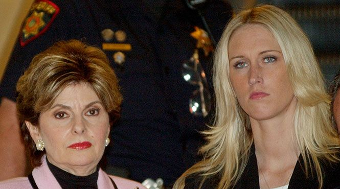 Amber Frey, right, leaves a Redwood City, Calif., courtroom with her attorney Gloria Allred, left, after she was questioned by attorney Mark Geragos during the Scott Peterson trial, Tuesday, Aug. 24, 2004. Peterson is the Modesto, Calif., man who could face the death penalty for the murder of his wife, Laci Peterson, and their unborn son. (AP Photo/Paul Sakuma)