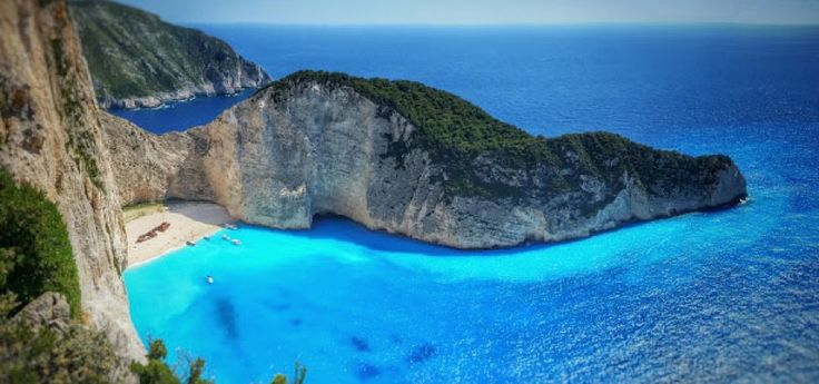 Navagio - Blue Caves!! | Volimes  This boat trip is full of blue! The first stop takes place at the famous Navagio the beach with the magical scenery. Then the boat stops at the Blue Caves a sculpture made by nature which must be seen by close.