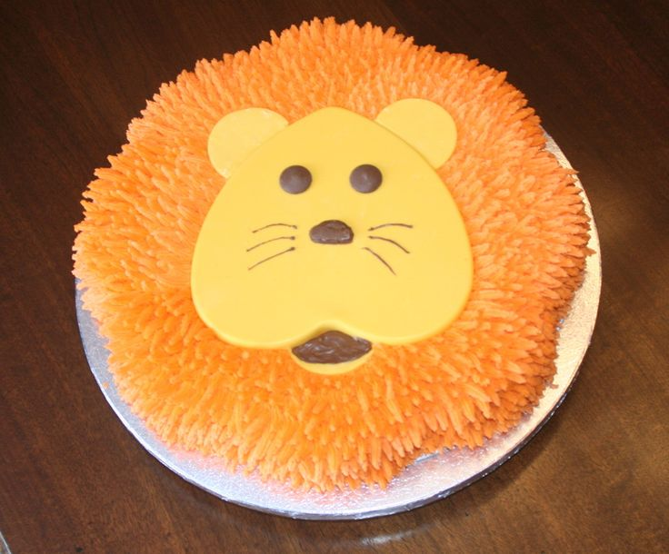 My son wanted a lion cake for his 3rd birthday.  The face is melted chocolate in a heart pan, ears made with a round cookie cutter and then ...