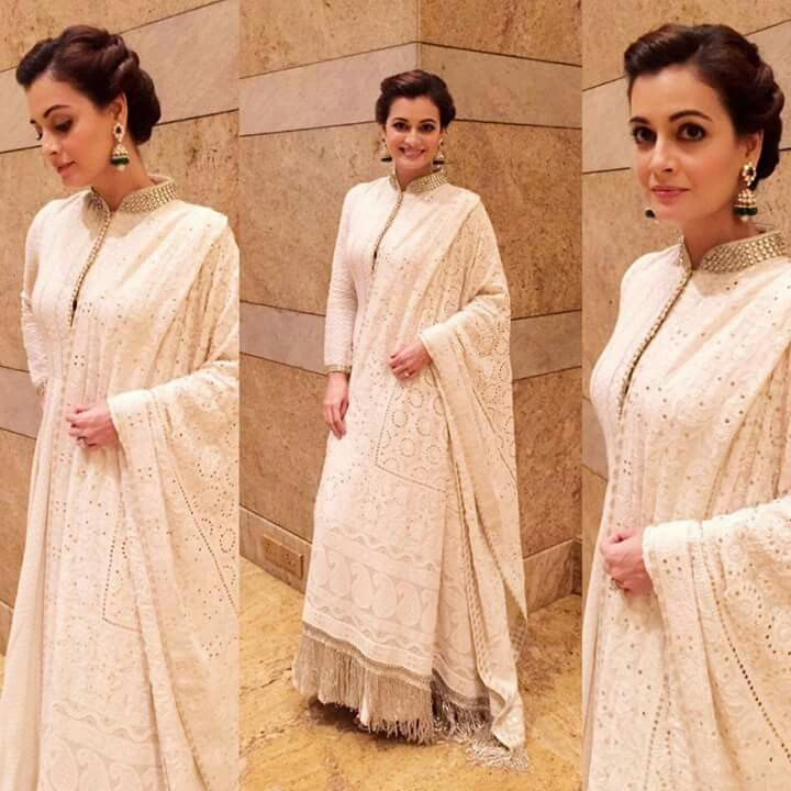 Vision in white!   Wearing a Chikankari handcrafted outfit by Diva'ni & Jewellery by Golecha Jewels, our lovely Dia graced Swades Foundation's charity event last night. Styled by Theia Tekchandaney, Dia's chic hair updo by Shobha Kewal was a perfect match to this elegant look!   - Team Dia