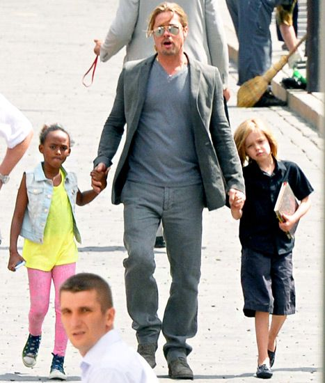 Brad Pitt held hands with daughters Shiloh, 7, and Zahara Jolie-Pitt, 8, following the premiere of World War Z in Russia on June 21.