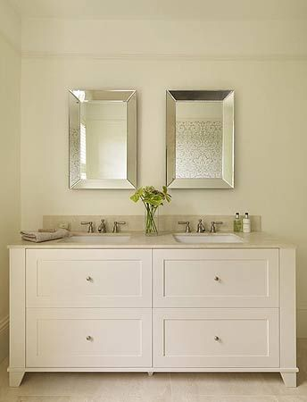 Classic fittings, luxurious Crema Marfil marble and bespoke furniture create a simple uncluttered look to this stunning bathroom - Ripples
